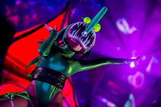 A performer in a sea creature costume