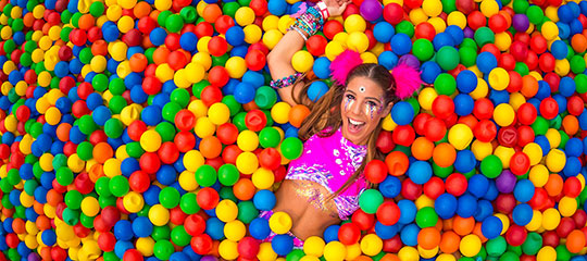A Headliner enjoys the VIP ball pit