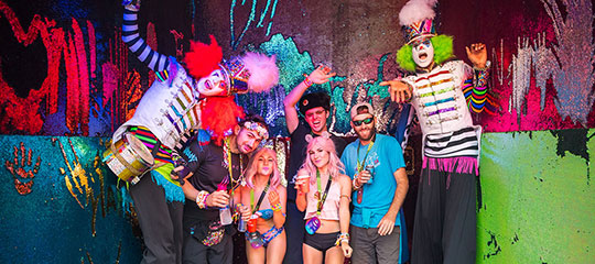 Headliners hang out with costumed performers in VIP