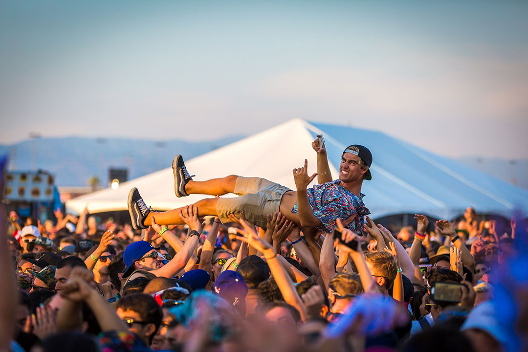 A fan crowd-surfing