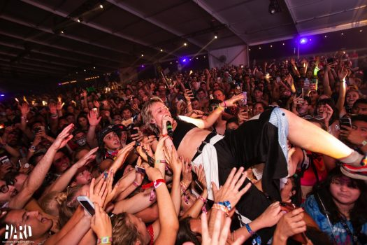 An artist crowd-surfing