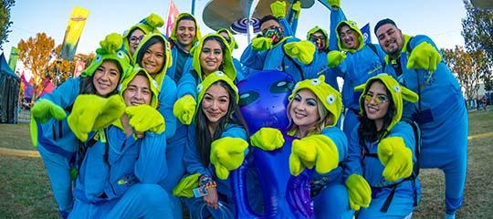 Friends in alien costumes